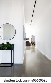 Contemporary new home entry and hallway with polished concrete floors