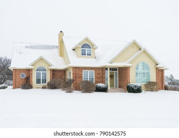 Contemporary North American home during a snowfall.