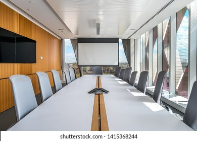 Contemporary office meeting room with a projection screen