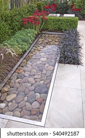 The contemporary patio area and water feature in a Relax and Reflective garden