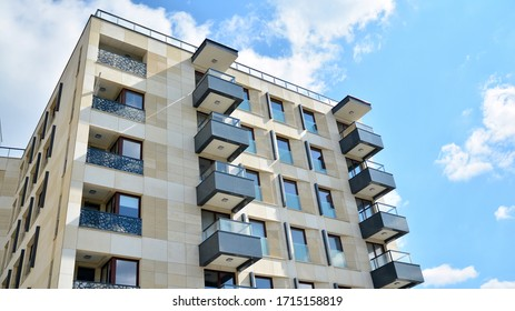 Contemporary residential building exterior in the daylight. Modern apartment buildings on a sunny day with a blue sky. Facade of a modern apartment building