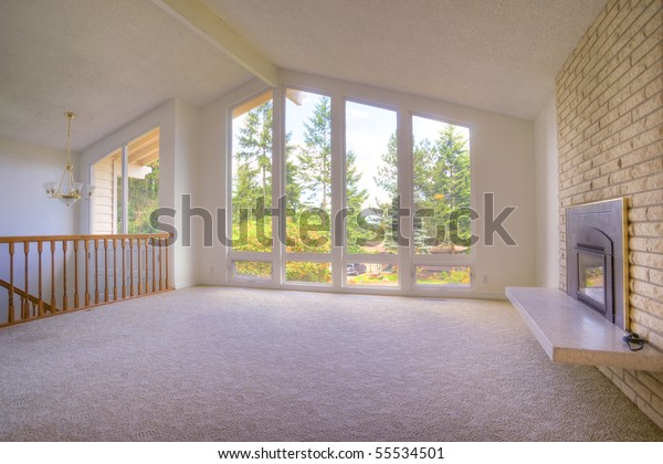 Contemporary room with fireplace cathedral ceilings and panoramic windows