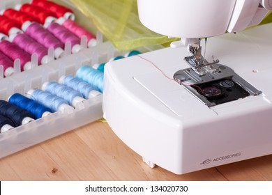 Contemporary sewing machine with colored spools.