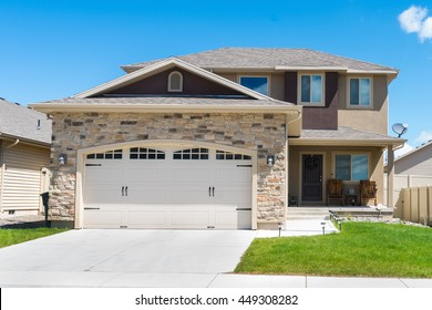 Contemporary split-level house with garage in front