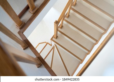 Contemporary stairway with wood handrail. Interior stairs. Staircase going down. Pathway of stairway or staircase inside a house. Interior structure design concept.