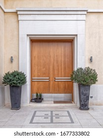 contemporary stylish house natural wood door with potted plants, Athens Greece