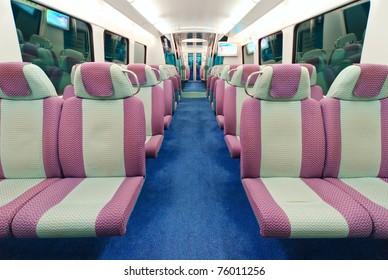 Contemporary train interior. Empty seats.