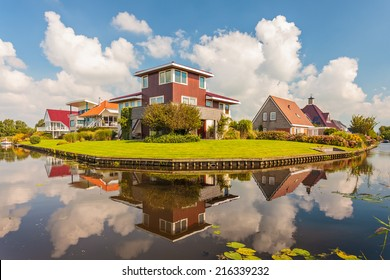 Contemporary villas alongside a pond in the province of Friesland, The Netherlands