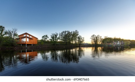 Contemporary wooden single family house. Perfect getaway. Wooden house on a island with oaks. organic architecture.