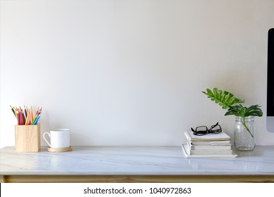 Contemporary workspace with books, colour pencils, gadgets and supplies. workspace and copy space