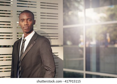 Contemporary young African businessman outside an office