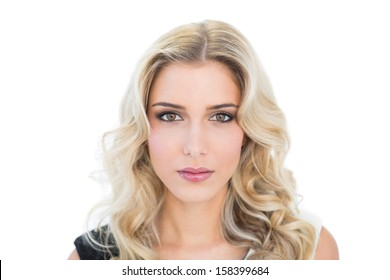 Content attractive blonde model looking at camera on white background