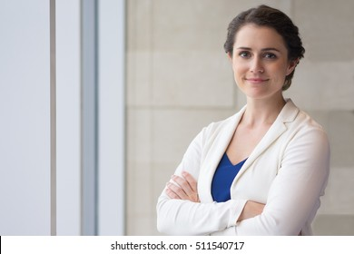 Content Beautiful Businesswoman Standing at Window