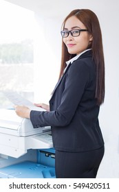 Content Business Lady Using Photocopier in Office
