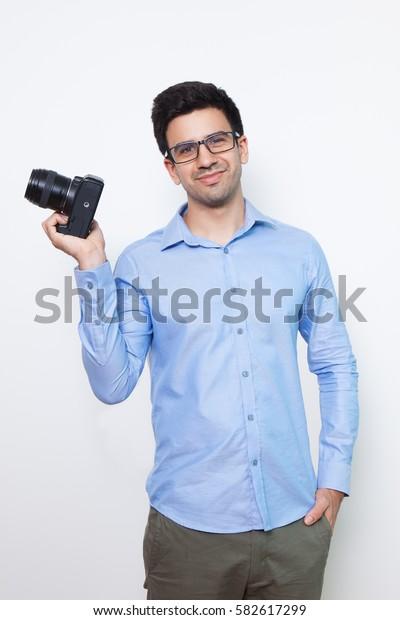 Content Confident Photographer Holding Camera