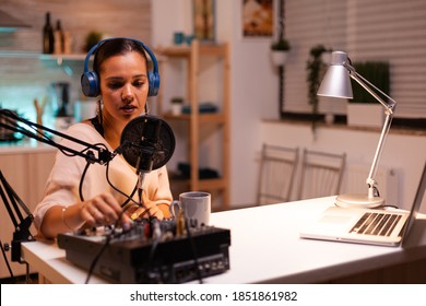 Content creator wearing headphones while recording new episode for podcast. Creative online show presenter On-air online production internet broadcast show host streaming live content, recording media