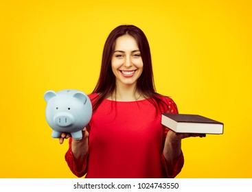 Content female student showing book and piggy bank content with savings and scholarship isolated on yellow background