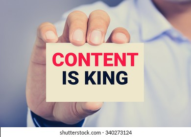 CONTENT IS KING message on the card shown by a man, vintage tone