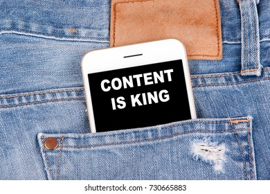 Content is king. Smartphone in jeans pocket. Technology business analysis and strategy background