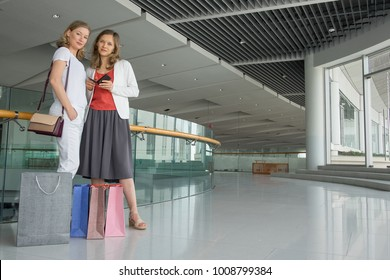Content Ladies with Purchases in Shopping Mall