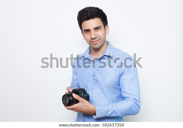 Content Male Photographer Holding DSLR Camera