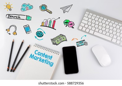 Content Marketing. Office desk table with computer, Smartphone, note pad, pencils
