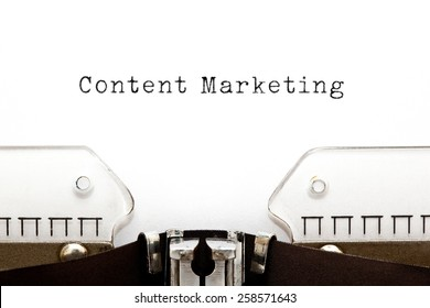 Content Marketing typed on white paper on old typewriter.