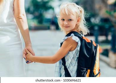 Content Schoolgirl Holding Mother Hand