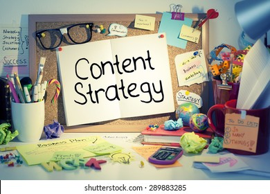 Content Strategy / Content marketing concept words on bulletin board in office interior