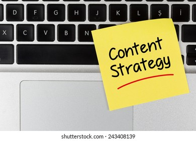 """Content Strategy"" Written on Sticky Note on Laptop Keyboard"