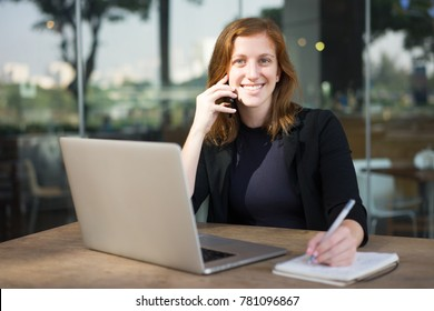 Content Woman Speaking on Phone and Smiling
