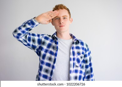Content Young Caucasian Guy Giving Salute