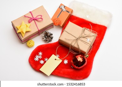 Contents of christmas stocking. Christmas celebration. Small items stocking stuffers or fillers little christmas gifts. Christmas sock white background top view. Fill sock with gifts or presents.