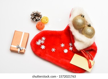Contents of christmas stocking. Christmas celebration. Christmas sock white background top view. Fill sock with gifts or presents. Small items stocking stuffers or fillers little christmas gifts.
