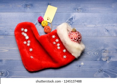 Contents of christmas stocking. Christmas sock toned wood background top view. Fill sock with gifts or presents. Celebrate christmas. Small items stocking stuffers or fillers little christmas gifts.