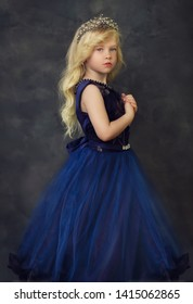 contepurary style little girl in blue gown portrait panterly look couture kid