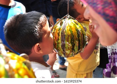 the contest to take coins from watermelons on the anniversary of the independence of the Republic of Indonesia on August 17, 2017 in Gadingsari, Sanden, Bantul, Special Region of Yogyakarta