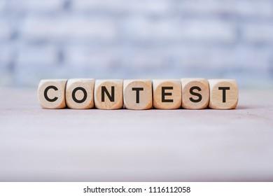 Contest word written on wood block