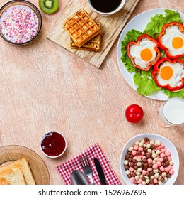 Continental breakfast with cereal, fried eggs, croissants, fruits and drinks on textured table, copy space. Plates with croissants, strawberries, cereal, jam. Top view