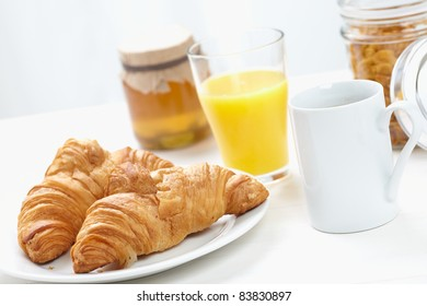 Continental Breakfast, coffee cereals, croissants,honey, orange juice
