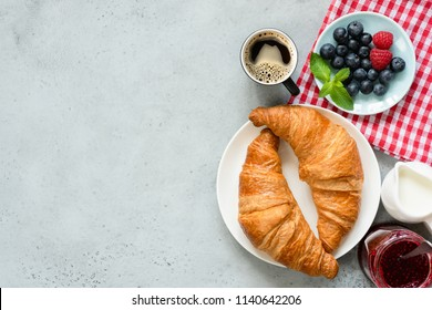Continental Breakfast Croissants Coffee Berries Jam On Concrete Background, Top View, Copy Space