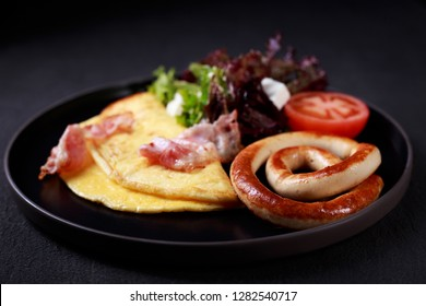 continental breakfast food, business lunch, restaurant menu, delicious nourishing morning meals, omelette with bacon, sausages and vegetable salad
