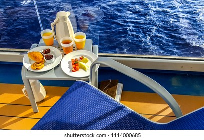 A continental breakfast presented on a balcony onboard a cruise ship