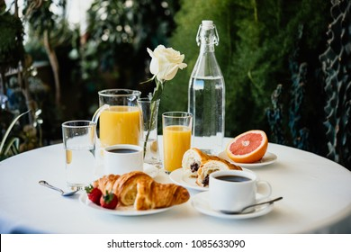 Continental breakfast served in a garden or cafe