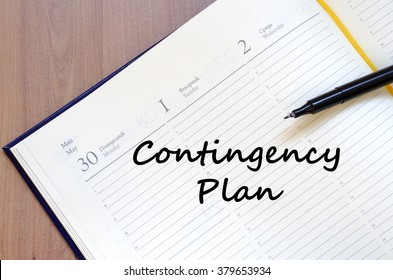 Contingency plan text concept write on notebook with pen