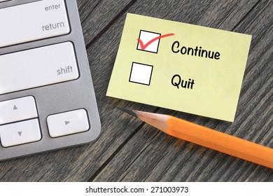 continue versus quit, decision making concept