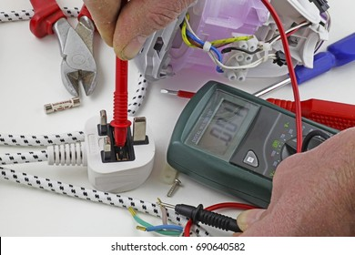 Continuity testing – An electrician testing for a fault on the live cable with a multimeter