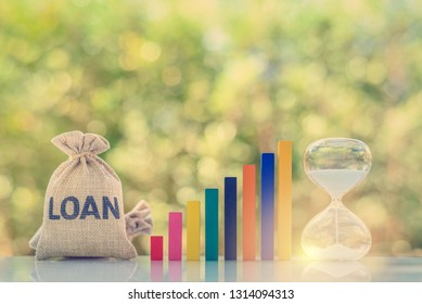 Continuous loan repayment / ordinary annuity concept : Loan bag, rising bar graph, hourglass on a table, depict borrower borrow money from lender and repay or payback regularly in same or equal amount