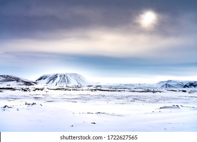 Contra jour snow covered mountain wilderness, north east Iceland in winter. Near Lake Myvatn