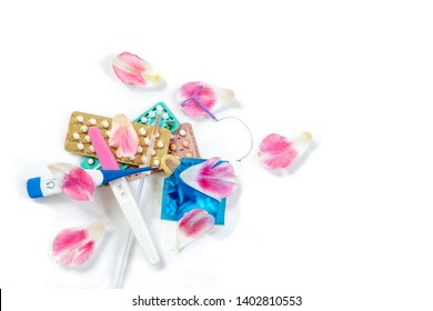 Contraception concept -several type of birth control method on a white background with roses petals